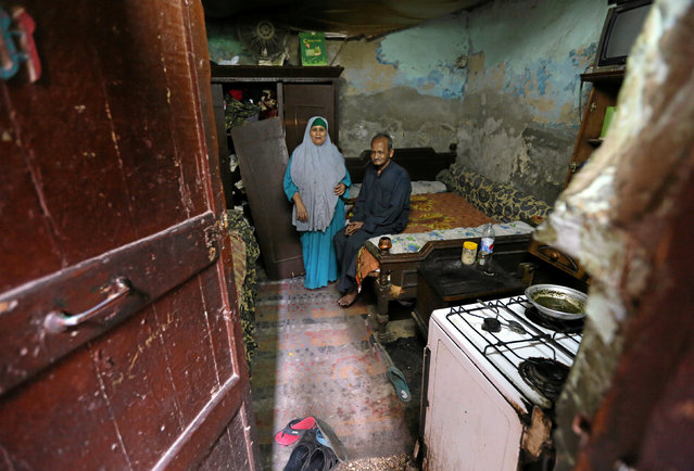 Saida Fathi Hassanein and her husband Abdul Razzaq Abou El Fadl, who are financially strapped, are seen their home in Ezbet Khairallah in Cairo, Egypt October 4, 2016. (Photo by Mohamed Abd El Ghany/Reuters)
