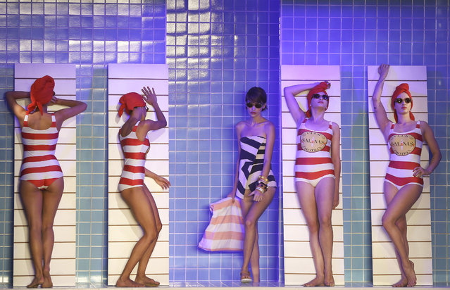 Models pretend to rest on chairs as they stand in creations from the Salinas collection during Sao Paulo Fashion Week in Sao Paulo, Brazil, Wednesday, April 25, 2018. (Photo by Andre Penner/AP Photo)