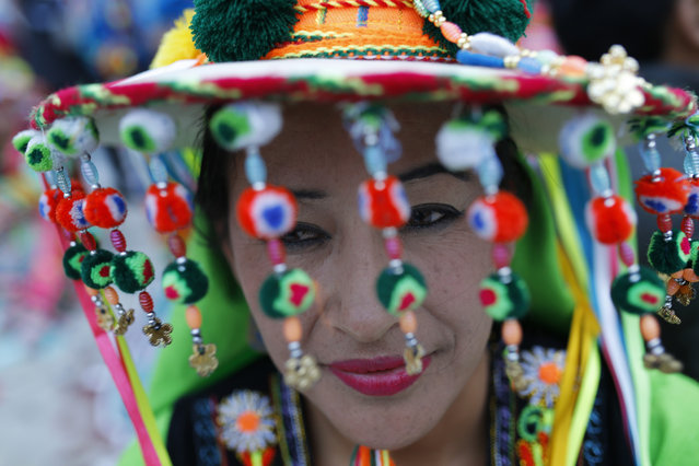 Bolivia's Gricelda dressed in a traditional Bolivian costume poses during a parade organised by Spanish leftist Podemos ('We Can') party as a pre-campaign meeting in Madrid, Sunday, November 22, 2015. During the parade dance folk groups from Bolivia, Peru and Ecuador performed along the streets of the city centre of the Spanish capital. (Photo by Francisco Seco/AP Photo)