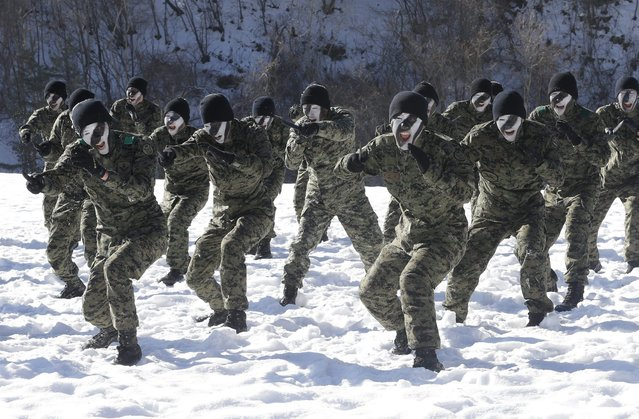 South Korea's Amry Special Warfare Command (SWC) soldiers demonstrate their martial arts skills during a winter exercise in Pyeongchang, South Korea, Thursday , January 8, 2015. (Photo by Ahn Young-joon/AP Photo)