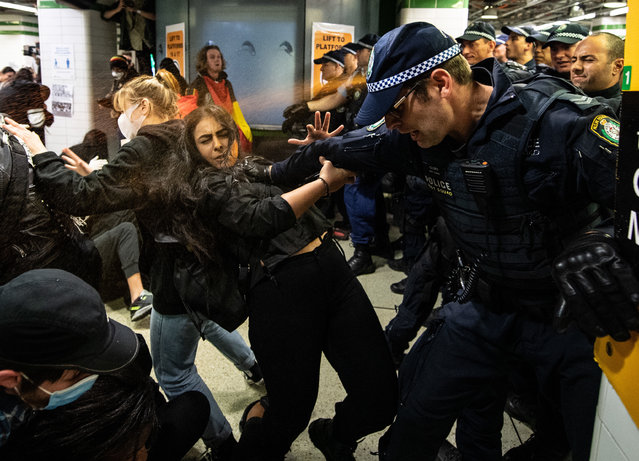 Police spraying protesters with pepper spray inside Central Station after a Black Lives Matter rally in Sydney, Australia, 06 June 2020, a protest against the deaths of Aboriginal people in custody and solidarity with the US protests for George Floyd. (Photo by James Gourley/EPA/EFE)