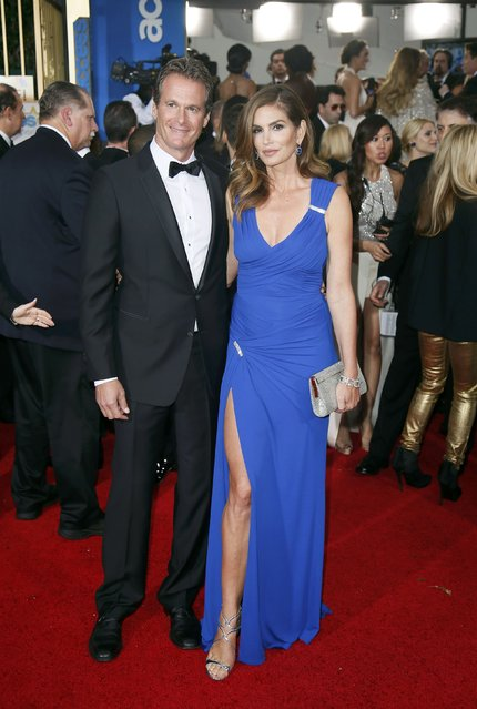 Rande Gerber and Cindy Crawford arrive at the 72nd Golden Globe Awards in Beverly Hills, California January 11, 2015. (Photo by Danny Moloshok/Reuters)