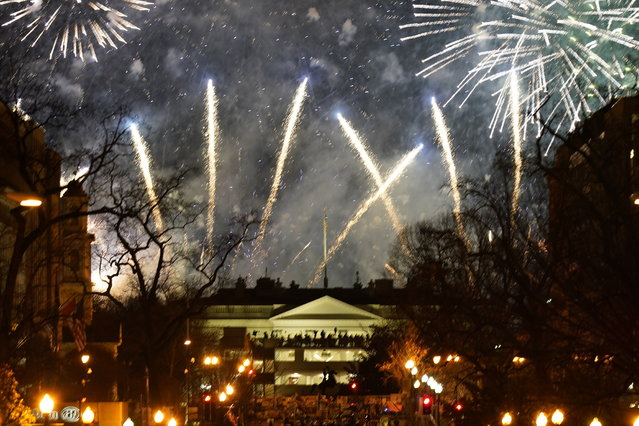 Fireworks light up the sky around the White House, Wednesday night, January 20, 2021, in Washington, as part of the festivities after President Joe Biden was inaugurated today. (Photo by Gerald Herbert/AP Photo)