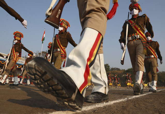 Indian Railway Protection Force (RPF) personnel march during Republic Day celebrations in Hyderabad, India, Tuesday, January 26, 2021. Tuesday's event marks the anniversary of the country's democratic constitution taking force in 1950. (Photo by Mahesh Kumar A./AP Photo)