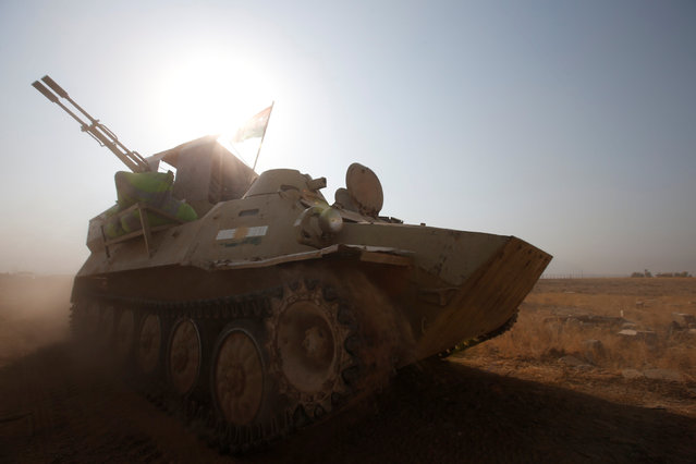 A military vehicle of Peshmerga forces drives towards the town of Bashiqa, east of Mosul, during an operation to attack Islamic State militants in Mosul, Iraq, November 7, 2016. (Photo by Azad Lashkari/Reuters)