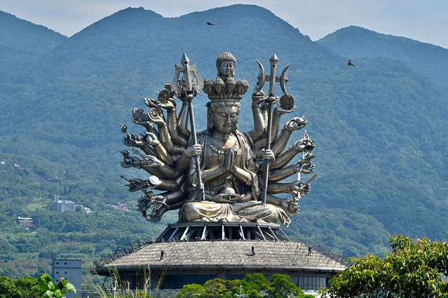 Local workers on a temple, the world largest stainless steel guanyin status at the Yuan Dao Guanyin Taoist temple at Tamsui district, in New Taipei City on September 9, 2020. (Photo by Sam Yeh/AFP Photo)