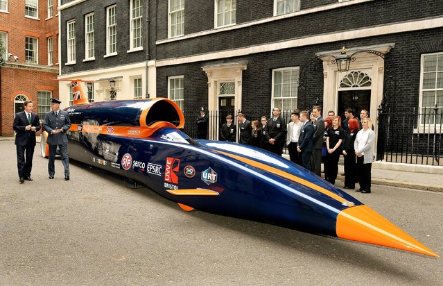 The Prime Minister David Cameron talks to RAF Pilot Andy Green about the British built Bloodhound Jet Car, that he will drive to try and smash the World land speed record of 763mph, on the day the PM announces the initiative to create 100,000 engineering jobs outside Downing Street Westminster in central London, on June 24, 2013. (Photo by John Stillwell/PA Wire)