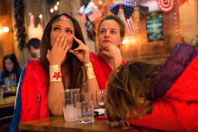 American Democratic Party supporters, one in a Wonder Woman costume, react to the news that Donald Trump has won the state of Florida at the Democrats Abroad election night party at Marylebone Sports Bar and Grill on November 9, 2016 in London, England. (Photo by Chris J. Ratcliffe/Getty Images)