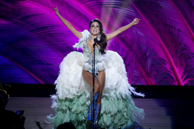 Miss Brazil, Melissa Gurgel, poses for the judges, during the national costume show during the 63rd annual Miss Universe Competition in Miami, Fla., Wednesday, January 21, 2015. (Photo by J. Pat Carter/AP Photo)