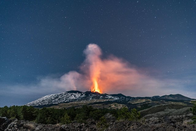 Mount Etna erupts in Sicily, Italy on February 21, 2021 sending plumes of ash and spewing lava into air. There was a major increase in volcanic activity that led to a paroxysmal event at the Southeast crater for the fourth time in the past six days. (Photo by Wead/Alamy Live News)