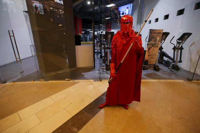 """A man dressed as a character from Star Wars poses for a picture during an event held for the release of the film """"Star Wars: The Force Awakens"""" at a movie theater in Guatemala City, December 16, 2015. (Photo by Jorge Dan Lopez/Reuters)"""