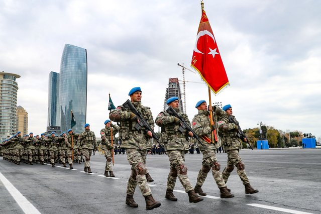 Members of a Turkish forces commando brigade take part in a military parade in which Turkey's President Recep Tayyip Erdogan and Azerbaijan's President Ilham Aliyev, looked on in Baku, Azerbaijan, Thursday, December 10, 2020. The massive parade was held in celebration of the peace deal with Armenia over Nagorno-Karabakh that saw Azerbaijan reclaim much of the separatist region along with surrounding areas. (Photo by AP Photo/Stringer)