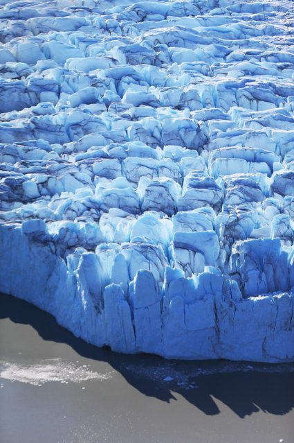 The surface of the glacier is seen on July 10, 2013 in Kangerlussuaq, Greenland. (Photo by Joe Raedle/Getty Images via The Atlantic)