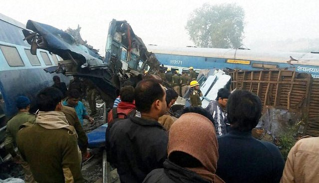 Officials carry out rescue work after around 90 people were killed and 150 injured when 14 coaches of the Indore-Patna express derailed in Kanpur Dehat on Sunday, 20 November 2016. (Photo by Press Trust of India)