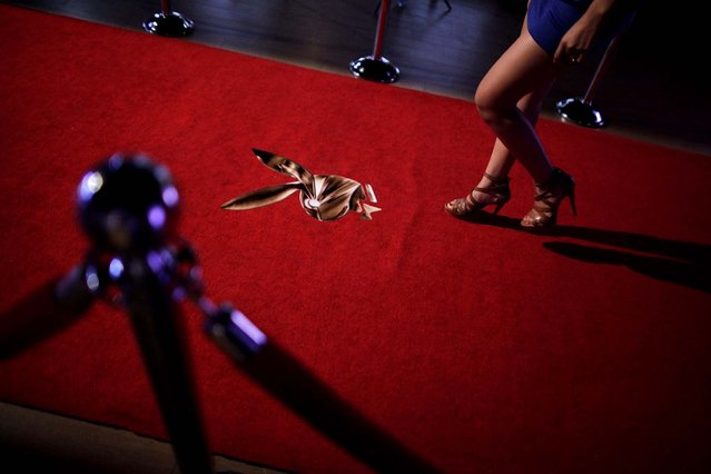 "A young woman walks towards a stage to be photographed while applying for a job as a Playboy bunny during a casting in Monterrey. Playboy is doing ""Bunny Hunt 2013"" castings in several Mexican cities for the Playboy casino in Cancun, on August 7, 2013. (Photo by Daniel Becerril /Reuters)"