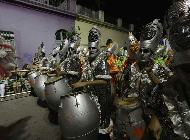 Members of a comparsa, a Uruguayan carnival group, play the drums during the Llamadas parade in Montevideo February 5, 2015. (Photo by Andres Stapff/Reuters)