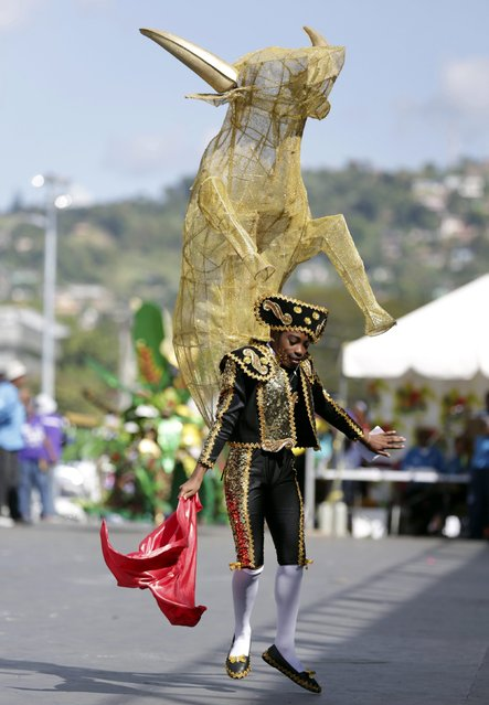 A reveller parades on stage at the annual Trinidad and Tobago Red Cross Society's Children's Carnival Competition at the Queen's Park Savannah in Port-Of-Spain February 7, 2015. (Photo by Andrea De Silva/Reuters)