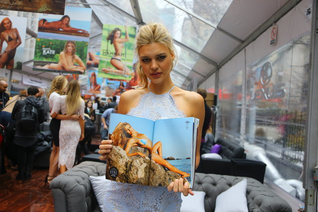 Sports Illustrated swimsuit model Kelly Rohrbach holds the 2015 Sports Illustrated swimsuit issue during the SwimCity festival in New York City on Monday February 9, 2015. (Photo by Gordon Donovan/Yahoo News)