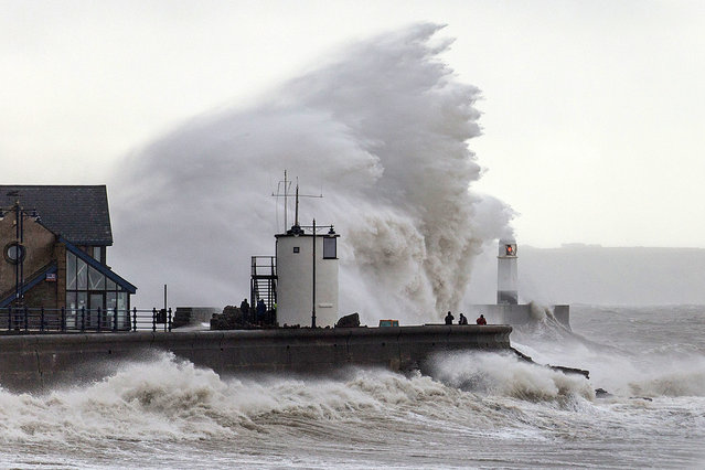 Huge waves batter the seafront at Porthcawl in Wales, UK during high tides and severe winds on August 20, 2016. (Photo by Tim Bow/Apex News)