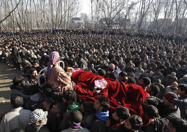Kashmiri villagers carry the body of a civilian, Farooq Ahmad Bhat, during his funeral in Palhalan, north of Srinagar February 10, 2015. Bhat was killed and two others were injured on Monday in a clash between the Indian security forces and protesters who were demanding the mortal remains of Afzal Guru - a Kashmiri man, who was executed on February 9, 2013, for an attack on India's parliament in 2001, local media reported. (Photo by Danish Ismail/Reuters)