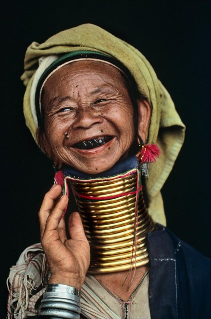 A rarity in Myanmar, a woman models her brass neck rings, Loikaw, Burma (Myanmar), 1994. (Photo by Steve McCurry)