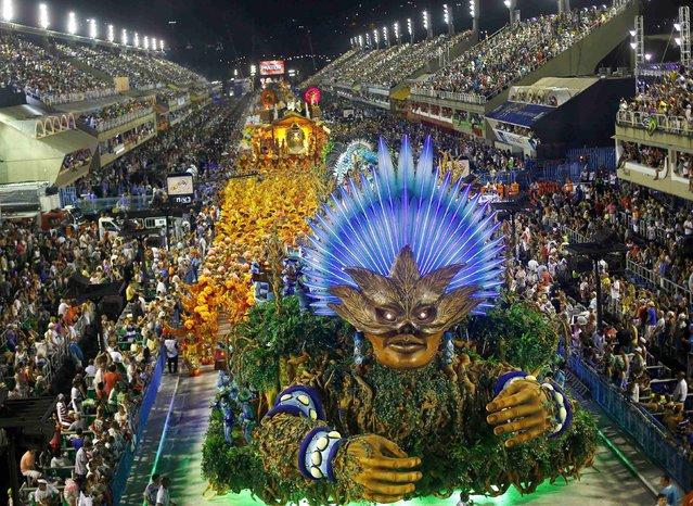 Revellers from the Vila Isabel samba school participate in the annual carnival parade in Rio de Janeiro's Sambadrome, February 16, 2015. (Photo by Ricardo Moraes/Reuters)