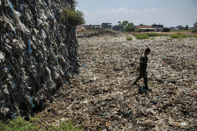 20 years worth of plastic trash fished out of the Citarum river sits at a dumpsite now being monitored by the Indonesian Army on August 28, 2018 outside Bandung, Java, Indonesia. (Photo by Ed Wray/Getty Images)