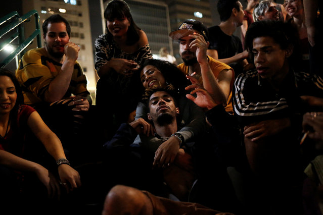 Members of lesbian, gay, bisexual and transgender (LGBT) community, that have been invited to live in a building that the roofless movement has occupied, spend time at Franklin Roosevelt Square in downtown Sao Paulo, Brazil, November 26, 2016. (Photo by Nacho Doce/Reuters)