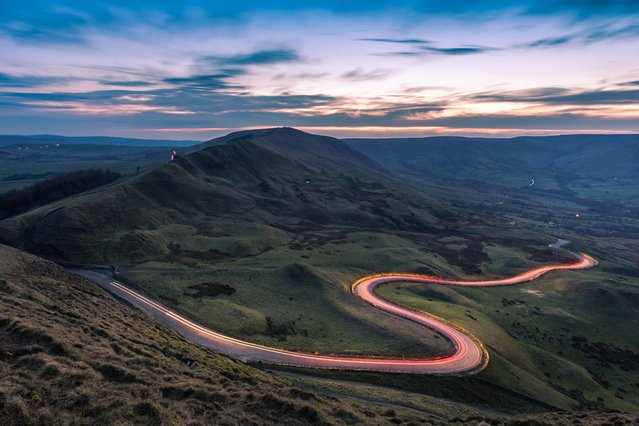 Light trails at Mam Tor, Derbyshire on April 2, 2016. (Photo by Dave Zdanowicz/Rex Features/Shutterstock)