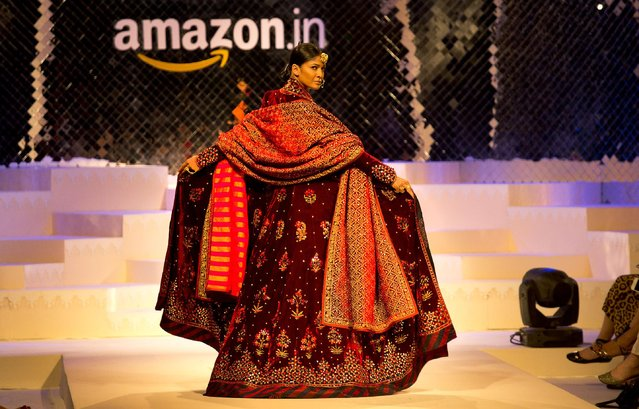 A model displays creation of Indian designer Rohit Bal during the grand finale of Amazon India fashion Week, in New Delhi, India, Sunday, March 29, 2015. (Photo by Manish Swarup/AP Photo)