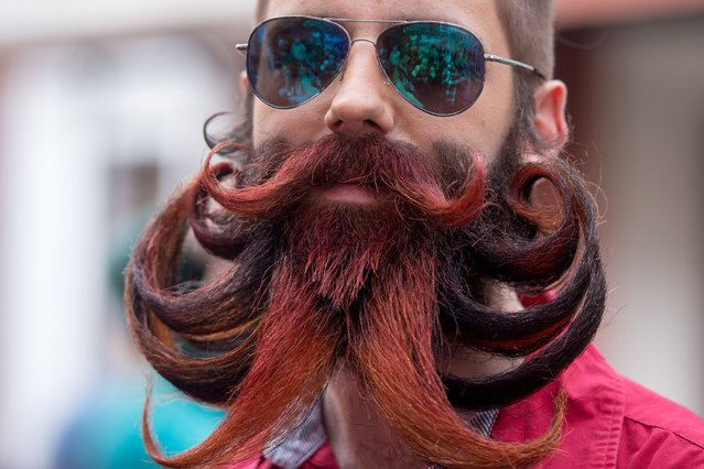 A man poses as he takes part in Russia's beard and mustaches championship in central Moscow on April 4, 2015. (Photo by Alexander Utkin/AFP Photo)