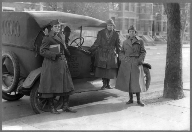 Members of The Women's Radio Corps stand beside an army car, circa February 1919, in this Library of Congress handout photo.. (Photo by Reuters/Bain Collection/Library of Congress)