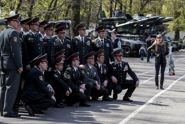 Ukrainian army officers pose for a picture after a graduation ceremony at the National University of Defence of Ukraine in Kiev, Ukraine April 24, 2015. (Photo by Gleb Garanich/Reuters)