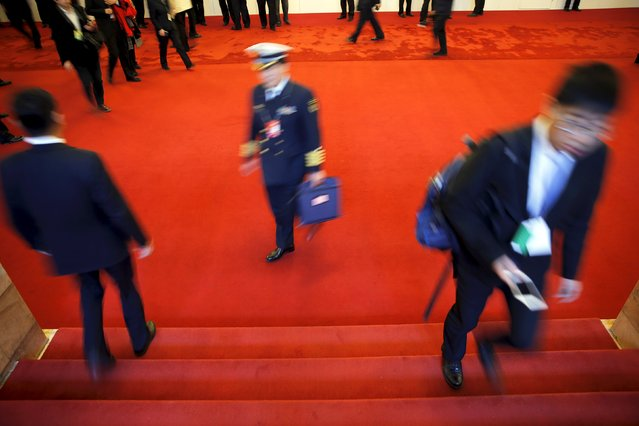 Delegates arrive at the Great Hall of the People during the third plenary session of the National People's Congress (NPC), in Beijing, China, March 13, 2016. (Photo by Damir Sagolj/Reuters)