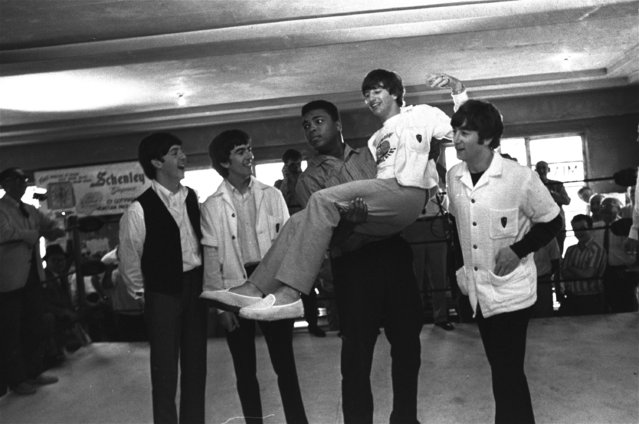 Boxer Cassius Clay lifts Ringo Starr, one of the Beatles into the air while the singers visited Clay's camp in Miami Beach, Fla. , February 18, 1964.  Others are, from left:  Paul McCartney, George Harrison, and John Lennon. (Photo by AP Photo)