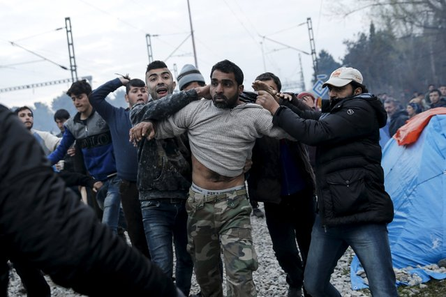 Refugees drag another refugee to the police, accusing him of abusing a young girl, at a makeshift camp at the Greek-Macedonian border near the village of Idomeni, Greece, March 17, 2016. (Photo by Alkis Konstantinidis/Reuters)