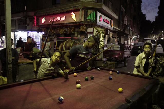 In this October 23, 2018 photo, children play billiards in Shubra, Egypt. (Photo by Nariman El-Mofty/AP Photo)
