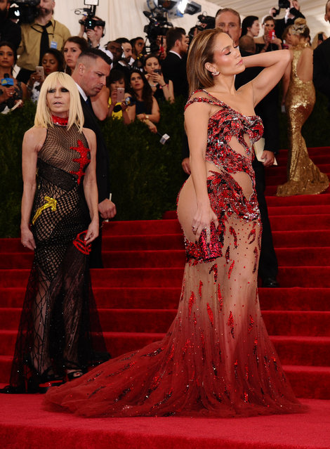 """Jennifer Lopez, right, and Donatella Versace arrive at The Metropolitan Museum of Art's Costume Institute benefit gala celebrating """"China: Through the Looking Glass"""" on Monday, May 4, 2015, in New York. (Photo by Charles Sykes/Invision/AP Photo)"""