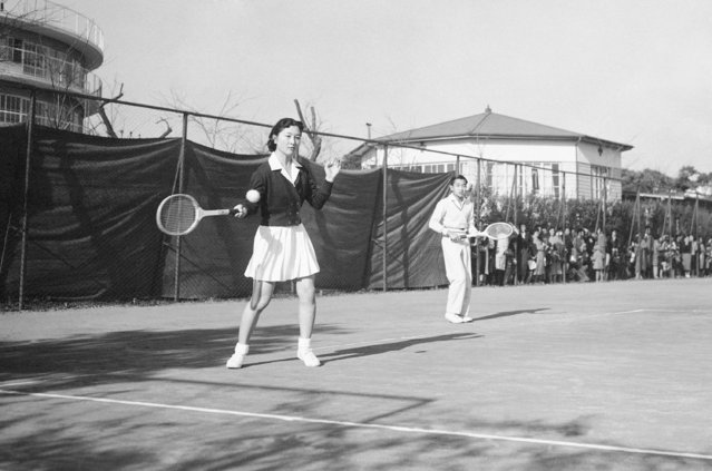 In this December 6, 1958, photo, Michiko Shoda takes the shot as she and her fiance, Crown Prince Akihito, team up for a mixed doubles tennis match at the Tokyo Lawn Tennis club. It was the first time the pair had been photographed together since their engagement was announced November 27. Miss Shoda will become Japan's first commoner queen in more than 2,000 years when Akihito assumes the thrown. When he abdicates April 30, 2019, Akihito will become the first emperor in Japan's modern history to see his era end without ever having a war. (Photo by AP Photo)