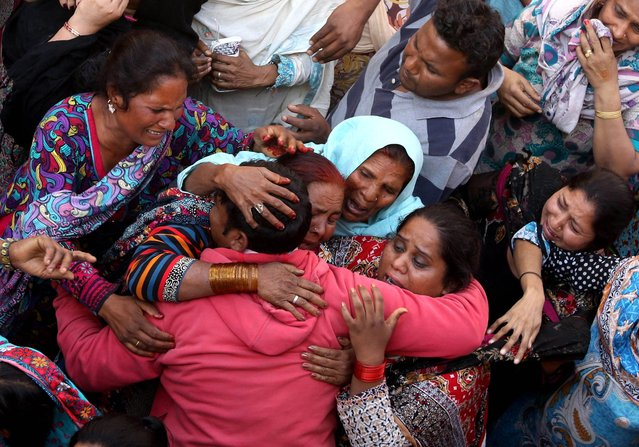 People cry during the funeral of their loved ones a day after a suicide bomb attack at a park, in Lahore, Pakistan, 28 March 2016. At least 70 people, including women and children, were killed in a suicide bomb attack on 27 March that targeted a public park in Lahore. Some 340 people were reportedly injured in the attack claimed by a splinter group of the Pakistani Taliban. (Photo by Rahat Dar/EPA)