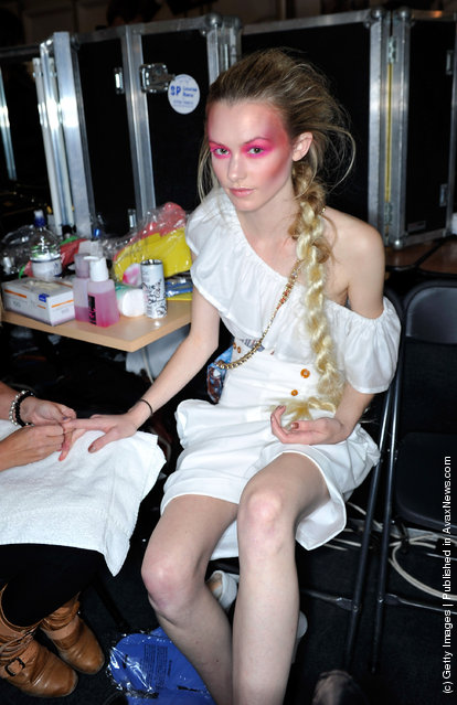 A model prepares backstage before the Vivienne Westwood show during London Fashion Week Spring/Summer 2012