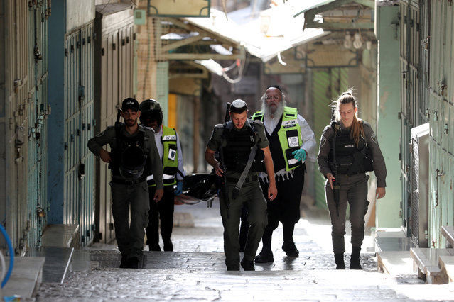 Israeli security and rescue personnel carry a dead body following a security incident in Jerusalem's old city, May 31, 2019. (Photo by Ammar Awad/Reuters)
