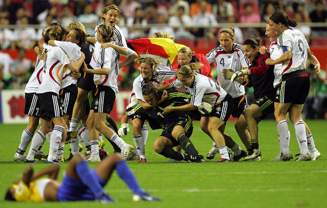 Germany celebrates their 2-0 win against Brazil during the FIFA Women's World Cup 2007 final match at Shanghai Hongkou Football Stadium on September 30, 2007 in Shanghai, China. (Photo by Ronald Martinez/Getty Images)