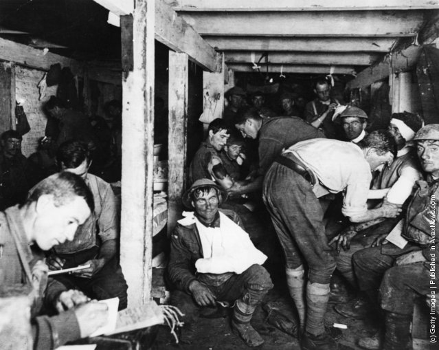 British tommies relaxing and having wounds treated in an underground forward dressing station by the Menin Road in France