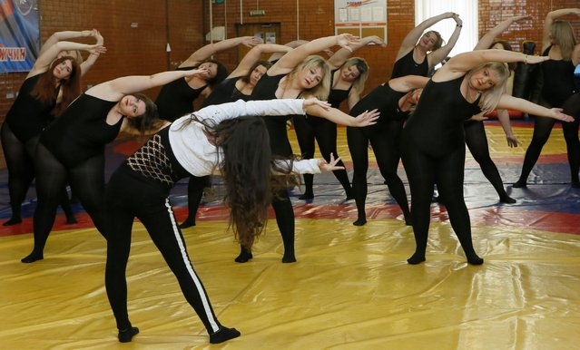 A trainer leads models of the SibPlus Models agency and participants of the Miss Doughnut beauty competition during a training session in Krasnoyarsk, Siberia, Russia, March 4, 2017. (Photo by Ilya Naymushin/Reuters)