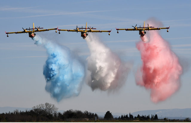 Civil security aircrafts parade during the inauguration of the Nimes-Garons civil security air force base on March 10, 2017 in Nimes, southern France. (Photo by Pascal Guyot/AFP Photo)