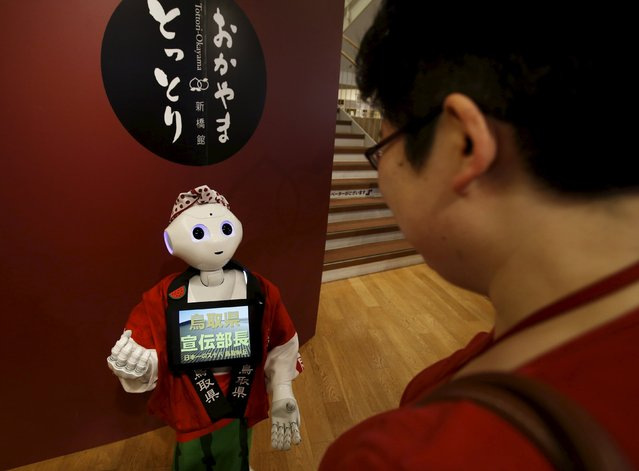 "SoftBank's human-like robot named ""Pepper"" speaks to a customer in its role as a PR manager of Tottori prefecture at the prefecture speciality store in Tokyo, Japan, July 1, 2015. (Photo by Yuya Shino/Reuters)"