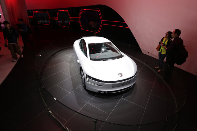 A Volkswagen XL1 hybrid car is displayed at Auto China 2014 in Beijing, April 20, 2014. Volkswagen will keep expanding Chinese operations and start selling battery-powered cars in the biggest auto market as the country rewards electric-vehicle buyers to tackle air pollution. (Photo by Jason Lee/Reuters)