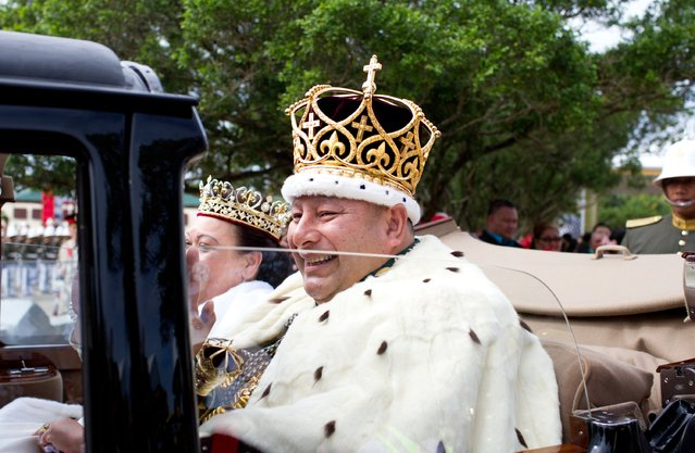 King Tupou VI and Queen Nanasipau'u proceed through the streets to the Royal Palace during the official coronation ceremony on July 4, 2015 in Nuku'alofa, Tonga. Tupou VI succeeds his brother, King Tupou V, who passed away in 2012. (Photo by Edwina Pickles/Getty Images/Fairfax Media)