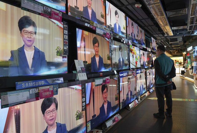 A man watches the television message that Hong Kong Chief Executive Carrie Lam makes an announcement on the extradition bill, at a home electronics retailer in Hong Kong, on Wednesday, September 4, 2019. Chief Executive Lam has announced the government will formally withdraw an extradition bill that has sparked months of demonstrations in the city, bowing to one of the protesters' demands. The bill would have allowed Hong Kong residents to be sent to mainland China for trials. It sparked massive protests that have become increasingly violent and caused the airport to shut down earlier this month. (Photo by Vincent Yu/AP Photo)